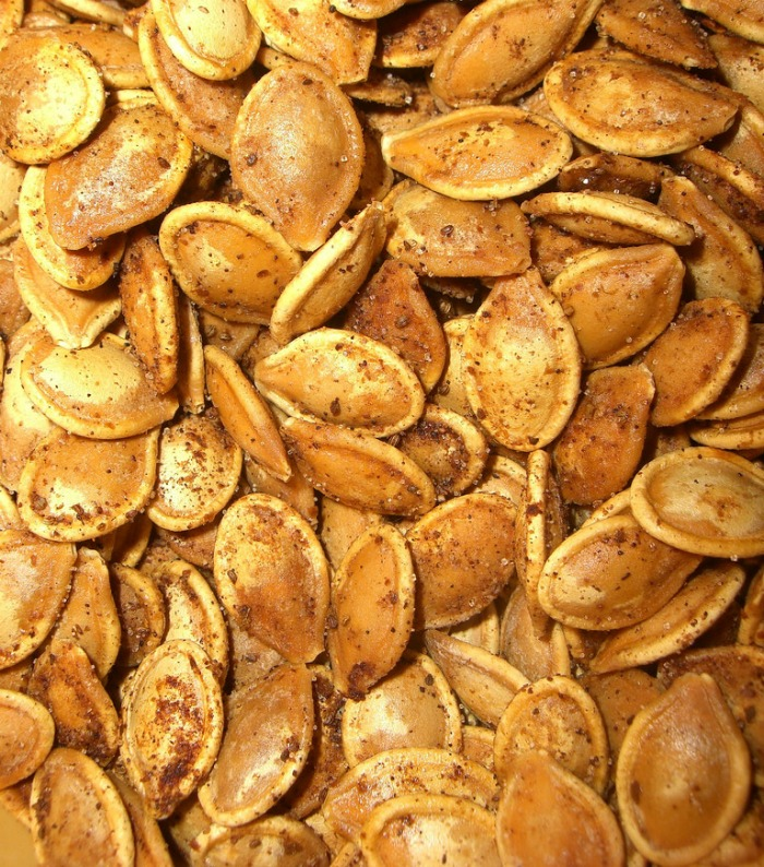 Toasted pumpkin seeds are a fun and salty Halloween snack.