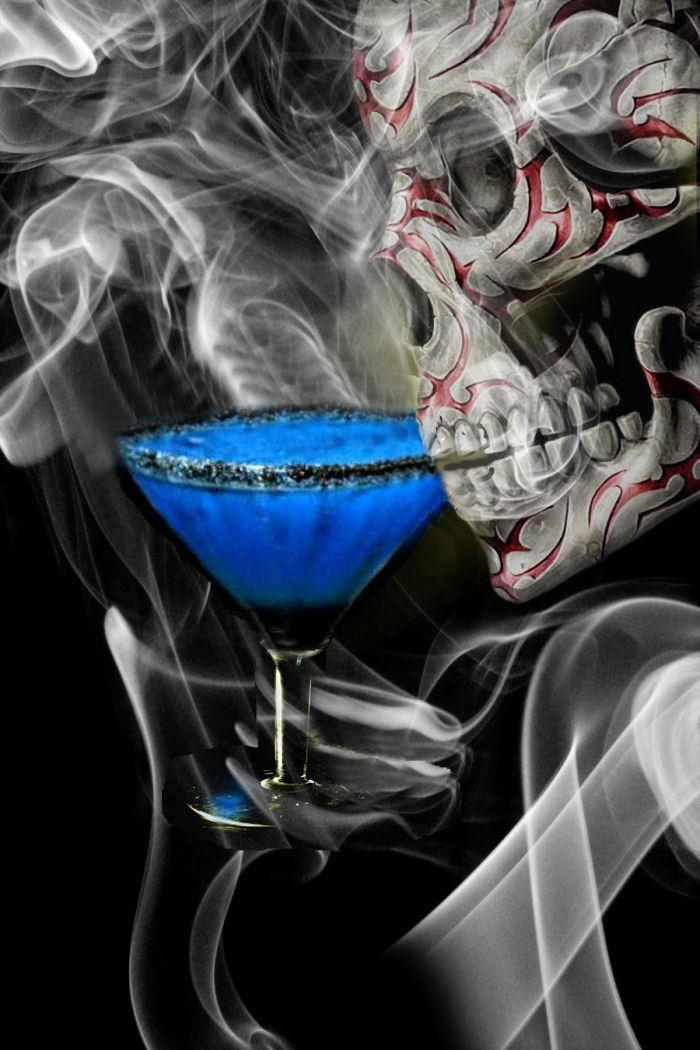 Skull drinking a Witches brew Halloween cocktails