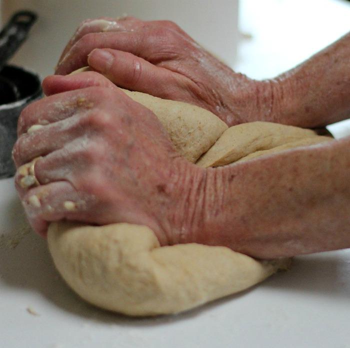 Hands neading bread