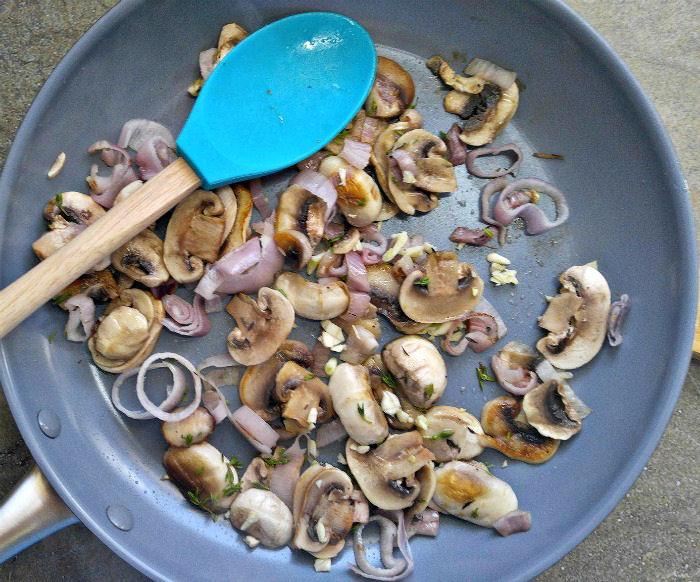 Cooking mushrooms, garlic and shallots