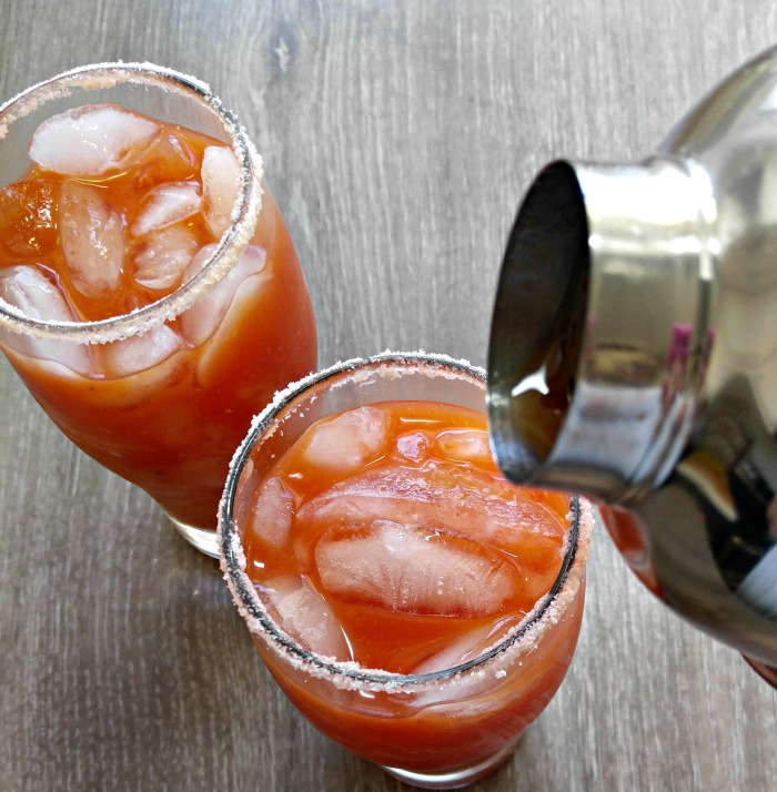 pouring a Bloody Mary cocktail
