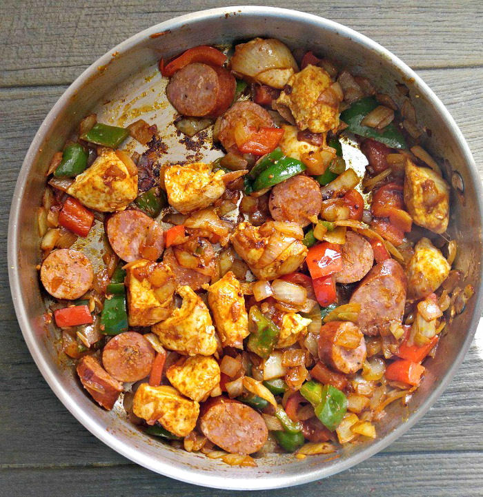 Add the chicken and sausage to the vegetables