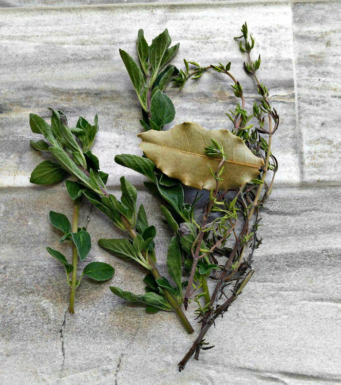 fresh oregano, thyme and dried bay leaf