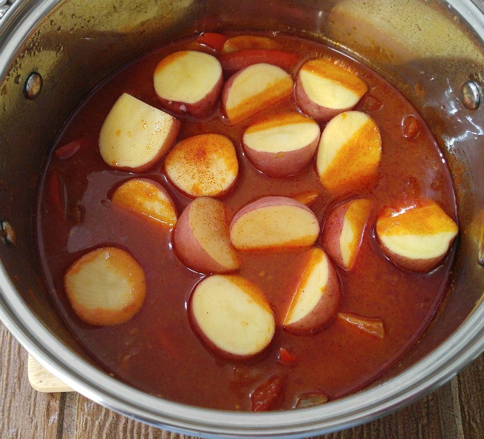 Adding potatoes to the one pot Whole30 beef stew