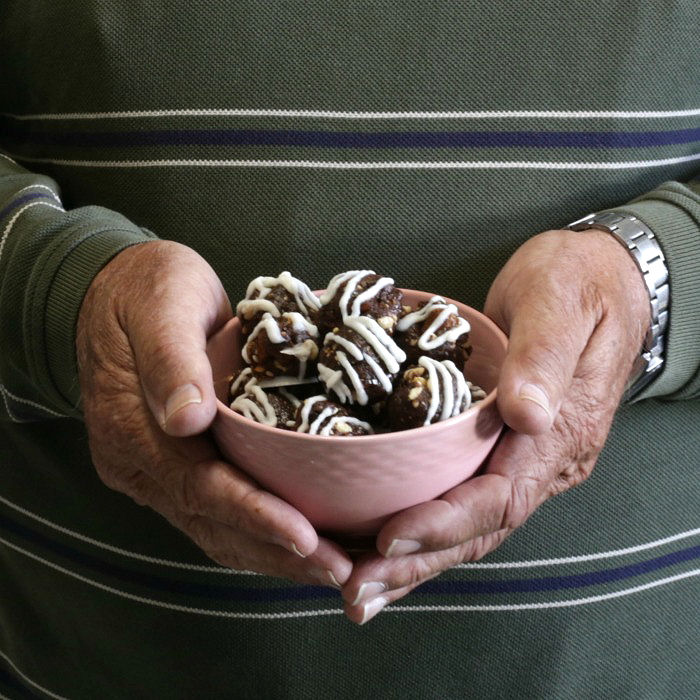 Holding a bowl of energy balls