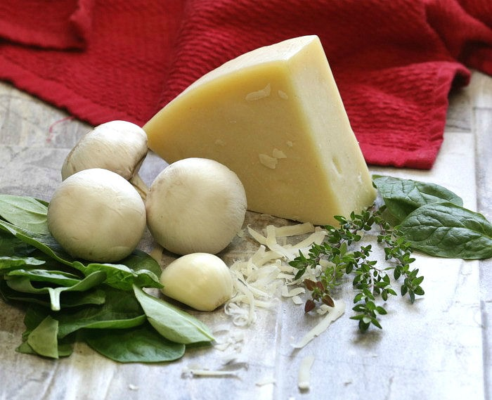 Fresh Parmesan, baby spinach, sliced mushrooms and fresh thyme leaves add a healthy touch to this recipe