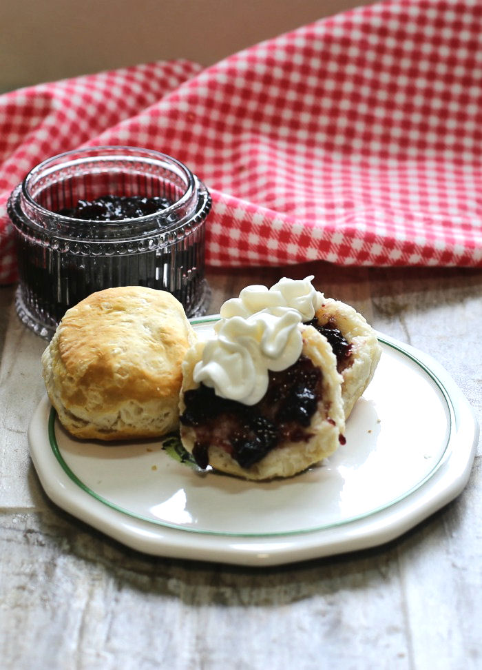 Biscuits with jam and whipped cream