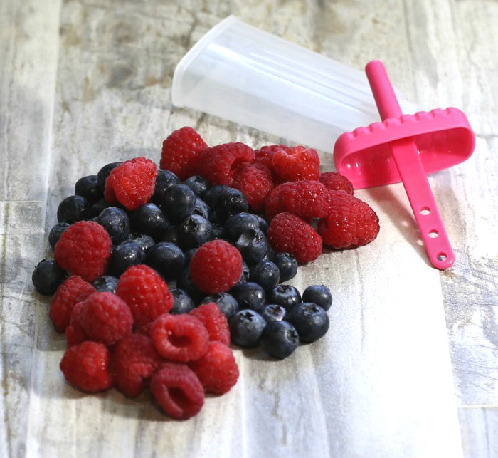 Raspberries and blueberries with a popsicle mold