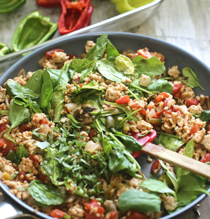 Barley and tomatoes with vegetables, spinach and fresh basil