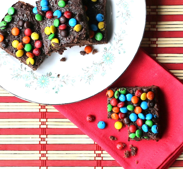 Taking a bite of box mix brownies with M and Ms