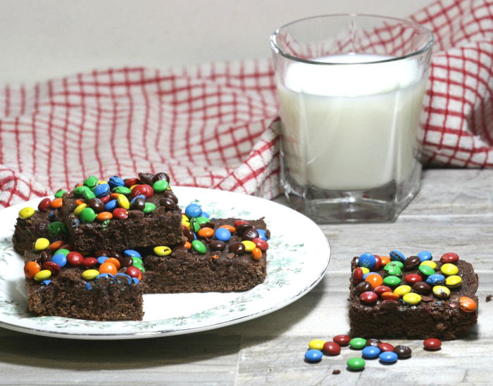 M & M brownies with a glass of milk