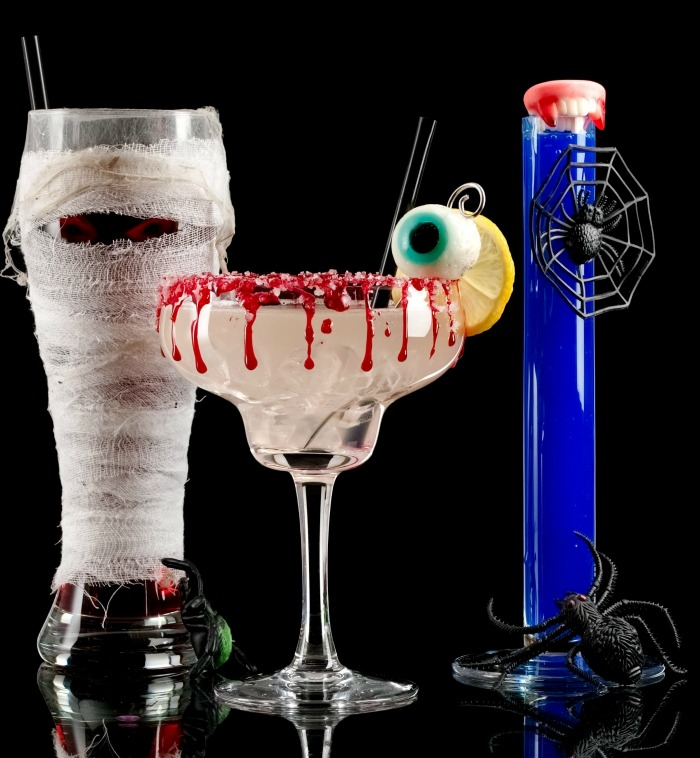 Halloween cocktails display with mummy and test tubes glasses.