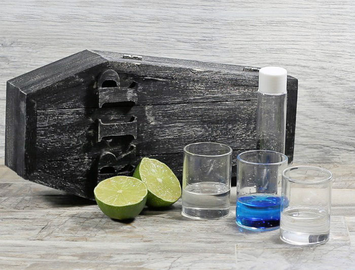 Blue curacao, triple sec, vodka and lime with sanding sugar and a coffin.