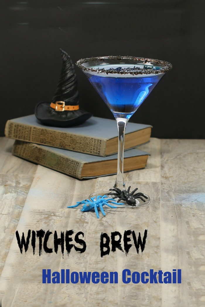 Witches brew Halloween cocktail and witch hat on books with spiders