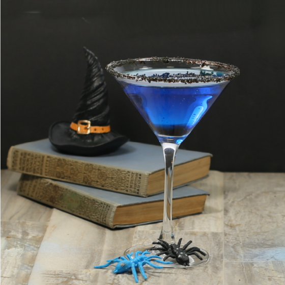 Witches brew Halloween cocktail and books