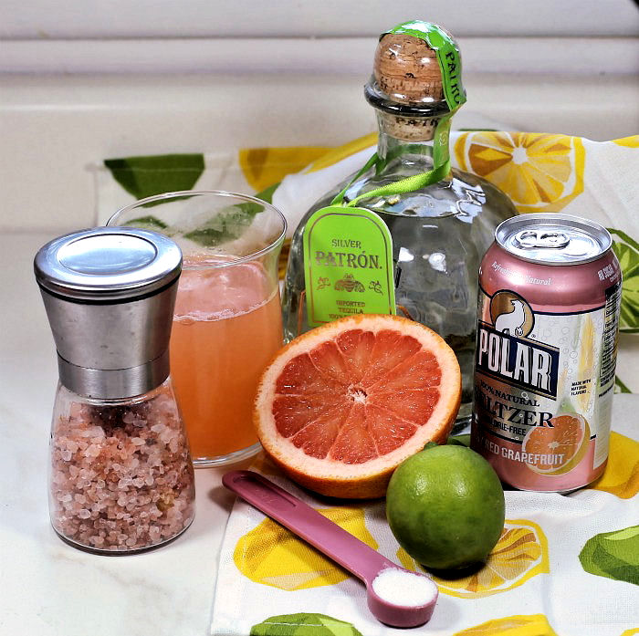 tequila grapefruit lime and other ingredients for a paloma cocktail