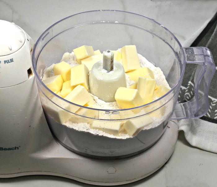 flour and salt with cold butter in a food processor