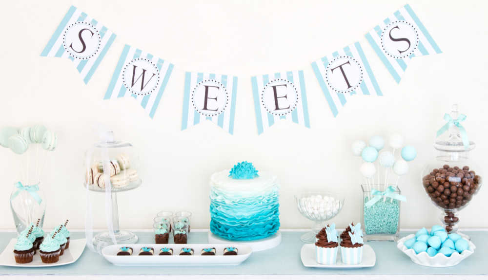 Sweets table with lots of blue desserts.