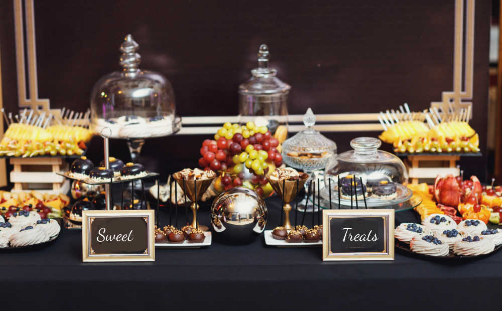 Party dessert table ideas: Cakes and other desserts on a table with lots of height.