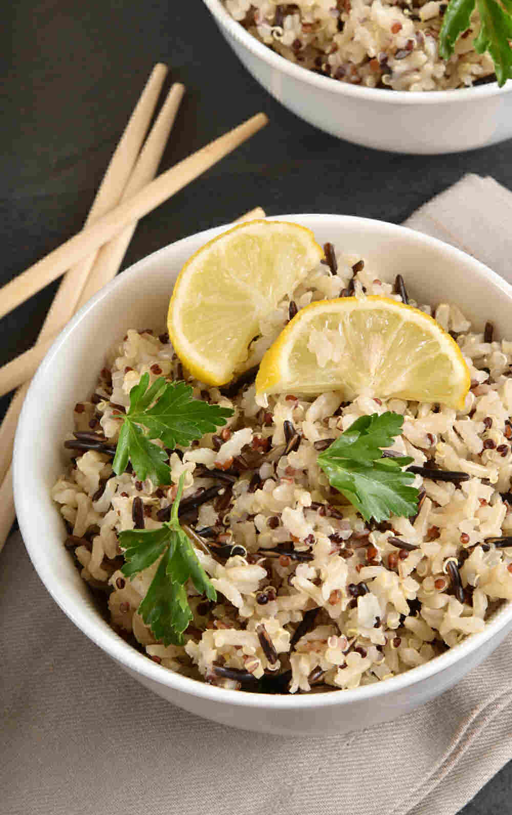 Wild and brown rice recipe with quinoa and chop sticks.